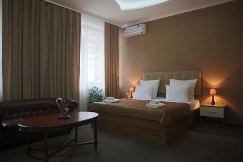 Кровать или кровати в номере Гостиница Альва Донна