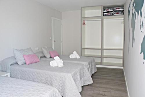 Cama o camas de una habitación en Apartamentos Credencial