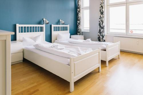 A bed or beds in a room at St Christopher's Apartments