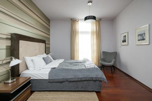 Lova arba lovos apgyvendinimo įstaigoje Yourplace Central Apartments
