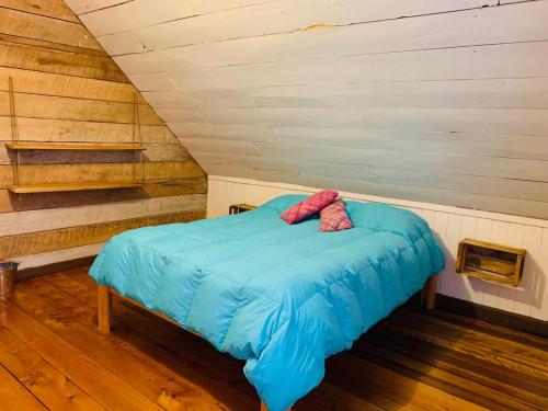 A bed or beds in a room at Casa Apel Hostel
