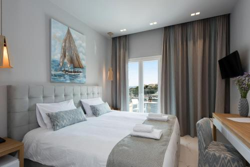 A bed or beds in a room at Melina Bay Boutique Hotel