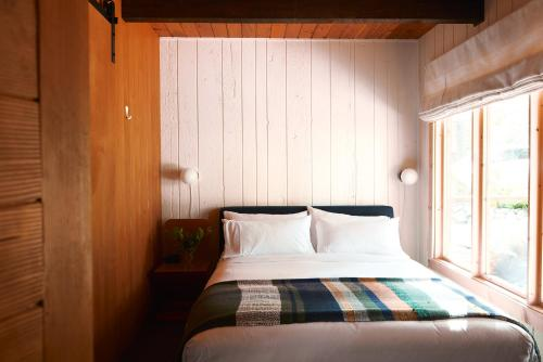 A bed or beds in a room at Captain Whidbey Inn