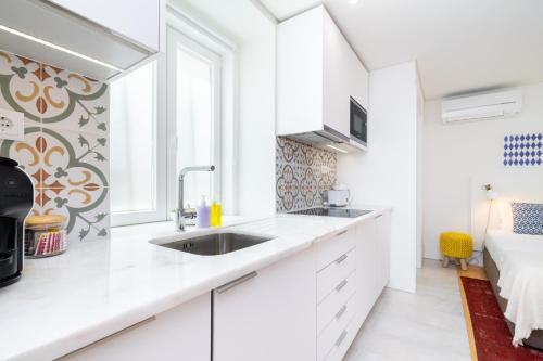Una cocina o zona de cocina en Porta do Mar | Deluxe Serviced Apartments
