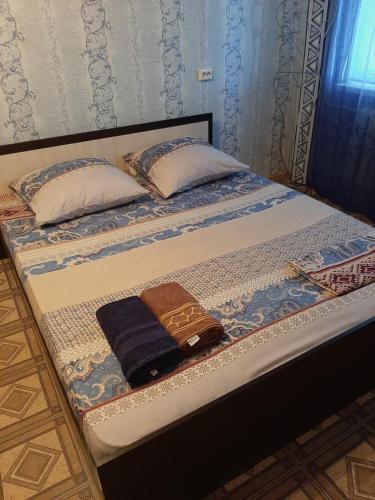 Кровать или кровати в номере Apartment Zhirnovskaya 13