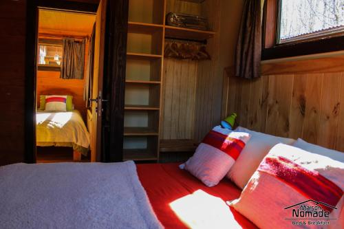 A bed or beds in a room at Maison Nomade