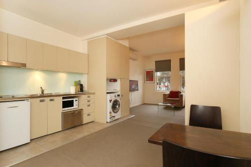 A kitchen or kitchenette at Plum Serviced Apartments North Melbourne