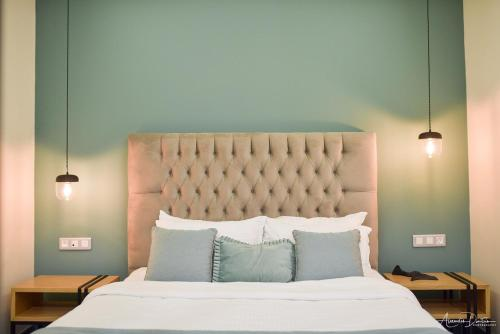 A bed or beds in a room at Thalassa Apart Hotel