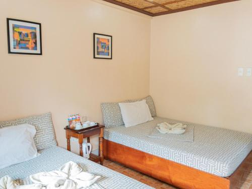 A bed or beds in a room at Inngo Tourist Inn