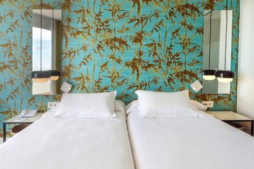 Een bed of bedden in een kamer bij HM Gran Fiesta