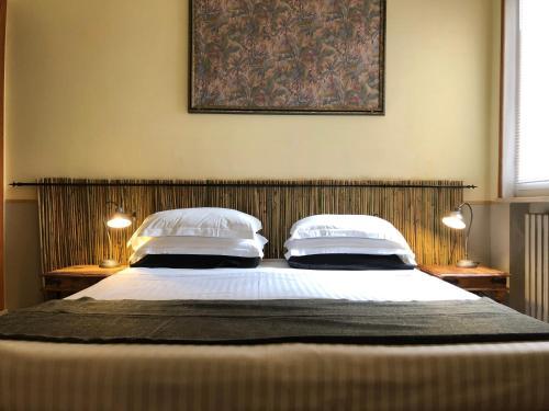Ein Bett oder Betten in einem Zimmer der Unterkunft Hotel Villa Belvedere