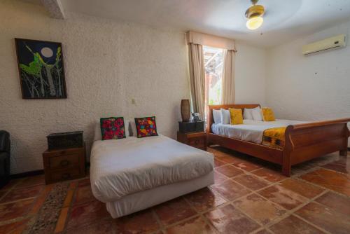 A bed or beds in a room at Casa de los Sueños Hotel Boutique