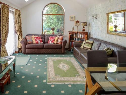 A seating area at Brook Lodge Country Cottage