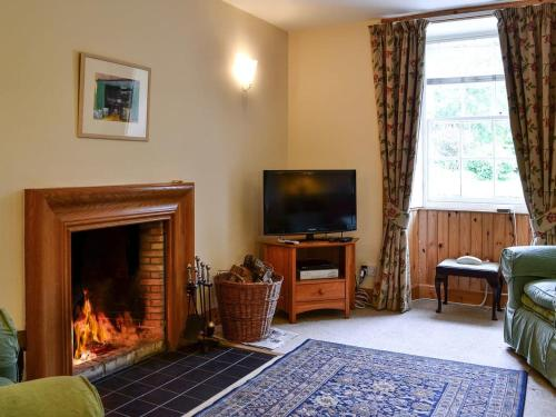 A television and/or entertainment center at Ferniehaugh Cottage