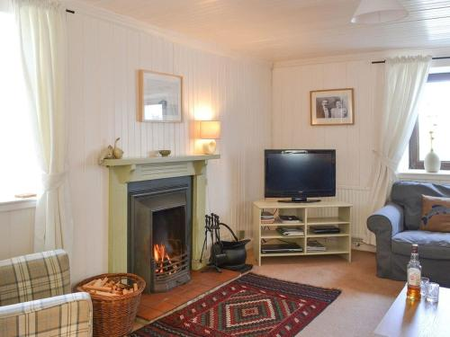 A television and/or entertainment center at The Ploughmans Cottage