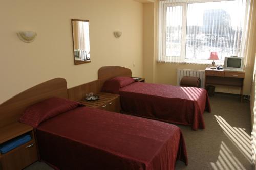 Кровать или кровати в номере Хинотель