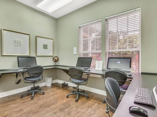 The business area and/or conference room at 2956 Lucaya Village - Gorgeous Four Bed Condo Close to Disney Area