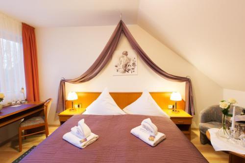 Кровать или кровати в номере Wendezeller Stuben
