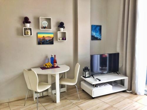 Télévision ou salle de divertissement dans l'établissement Los Ángeles Ático