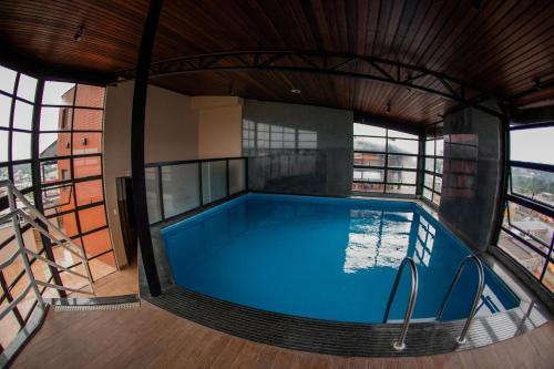 The swimming pool at or near Santa Catarina Plaza Hotel