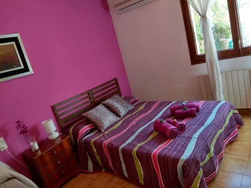 Llit o llits en una habitació de Cal Barber