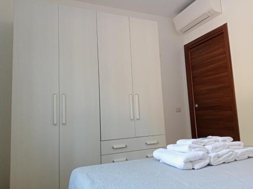 A bed or beds in a room at Casa Vacanze Maraldo