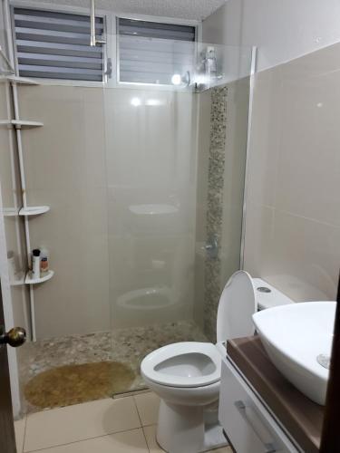A bathroom at Beach Front Apt Isla Verde Ave