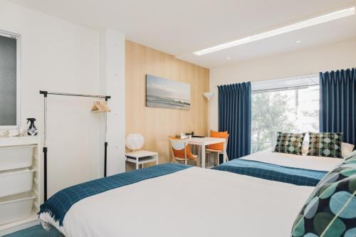 A bed or beds in a room at Namba Garden Square AFP Apartment Hotel