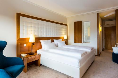 Ein Bett oder Betten in einem Zimmer der Unterkunft Hotel & Spa Der Steirerhof
