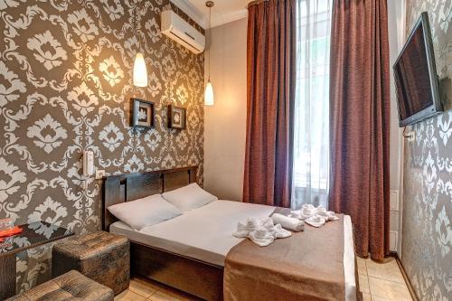 Кровать или кровати в номере Отель в Текстильщиках