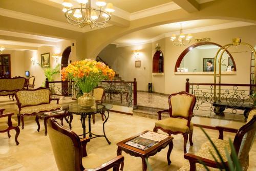 The lobby or reception area at El Cabildo Hotel