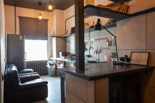 A kitchen or kitchenette at Riverside Hostel & Tours