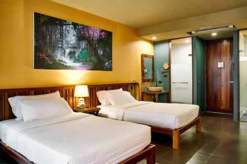 A bed or beds in a room at Avatar Railay - Adult Only