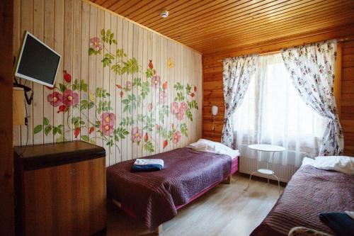Кровать или кровати в номере База Отдыха Green Village