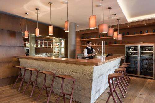 Lounge oder Bar in der Unterkunft Hotel Manggei Designhotel Obertauern