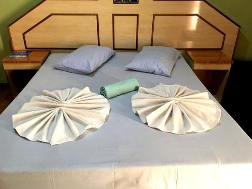 A bed or beds in a room at hotel Economico da SE