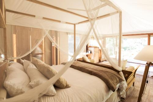 A bed or beds in a room at Turon Gates - Eco-Retreat