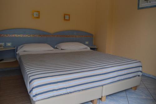 Letto o letti in una camera di Hotel Chentu Lunas