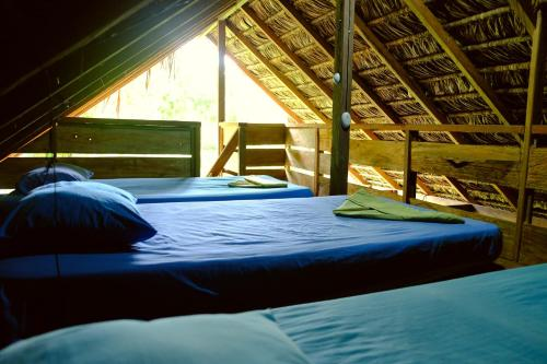 A bed or beds in a room at Kachikine