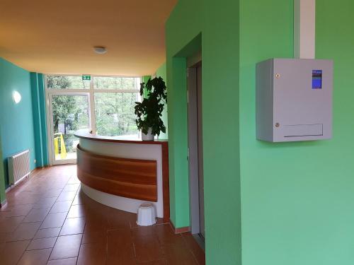 Lobby/Rezeption in der Unterkunft Der Quellenhof