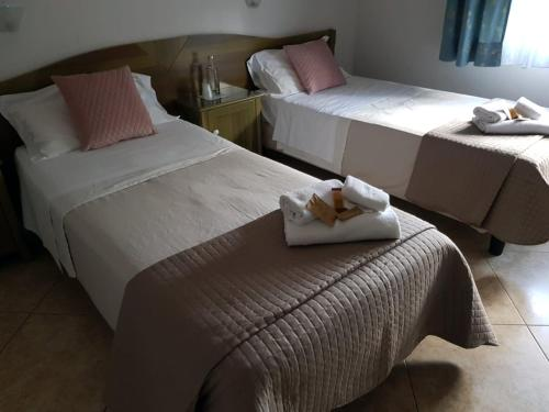 A bed or beds in a room at Hotel Monte Sirai