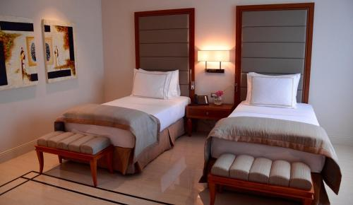 A bed or beds in a room at Grand Hotel Djibloho