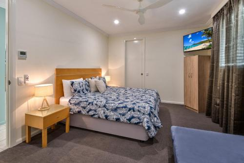 A bed or beds in a room at Pavillions on Hamilton Island