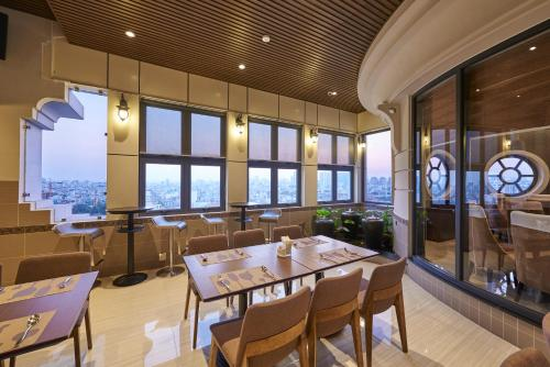 A restaurant or other place to eat at Athena Hotel