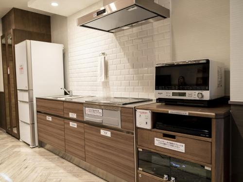 A kitchen or kitchenette at HOTEL PASELA LIVING