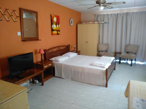 A bed or beds in a room at Rantzo Holiday Apartments