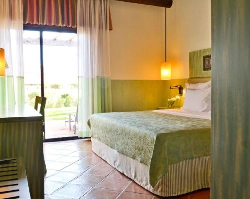 A bed or beds in a room at Pestana Vila Sol Golf & Resort Hotel