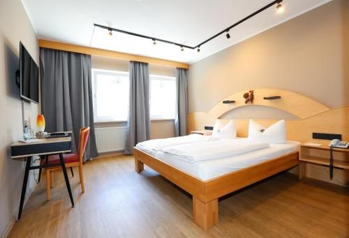 A bed or beds in a room at Arthotel ANA Goggl