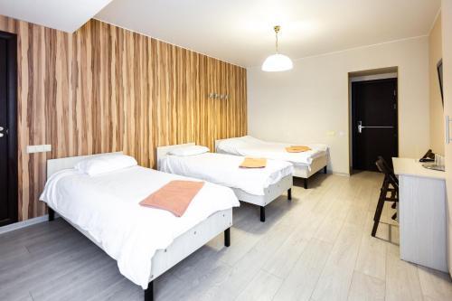 Кровать или кровати в номере Capital