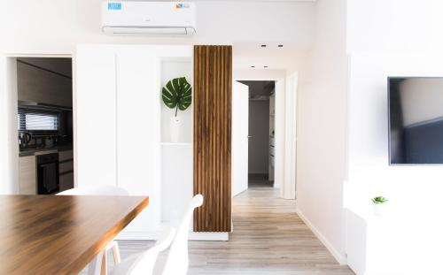 A television and/or entertainment center at Belgrano Luminous and Nordic Style